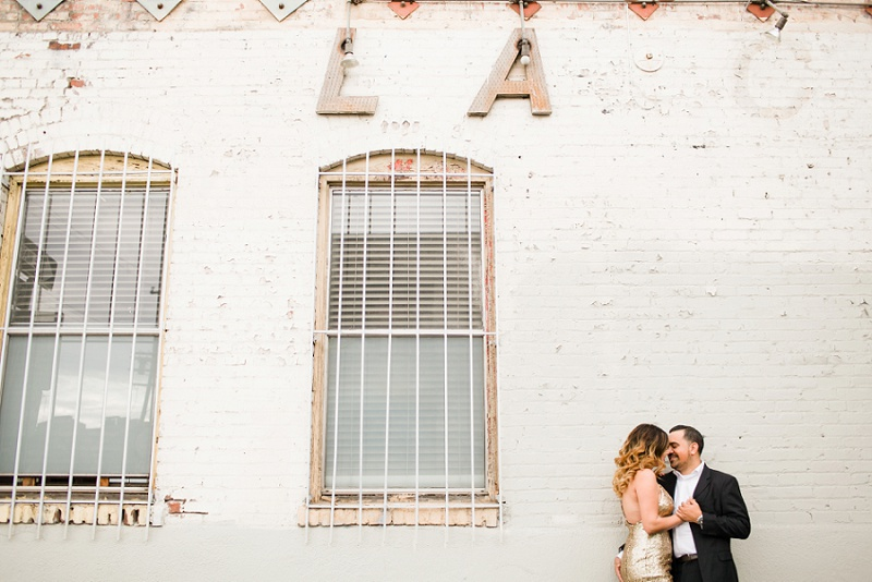 couple embracing in front of LA sign