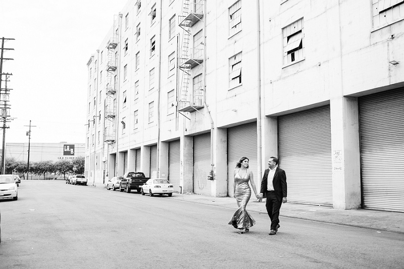 couple walking in front of warehouse in downtown los angeles