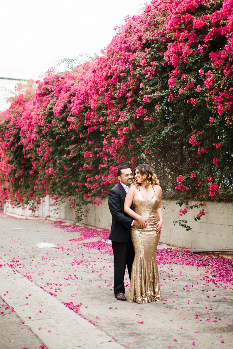 couple standing in front of bougainvilleas